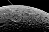 Dione+by+Cassini